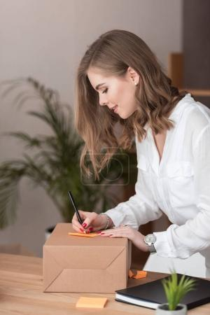 side view of attractive focused entrepreneur working at home office