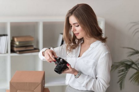 Photo for Portrait of entrepreneur taking picture of products for customers at home office - Royalty Free Image