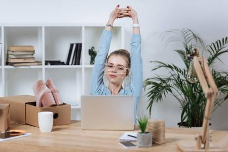 portrait of online shop proprietor resting during work at home office
