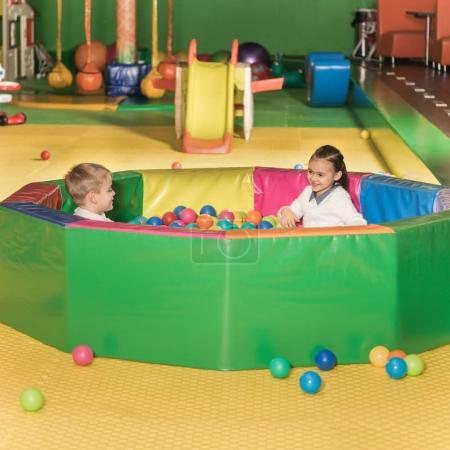 Photo for Adorable happy little children playing in pool with colorful balls - Royalty Free Image