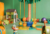 swings and colorful toys in entertainment center