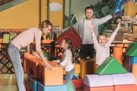 happy family playing with colorful blocks in entertainment center