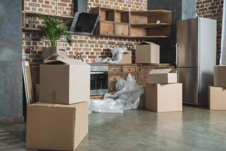 Photo for Cardboard boxes in empty kitchen during relocation - Royalty Free Image