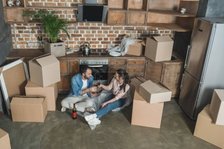 high angle view of couple drinking wine and celebrating relocation