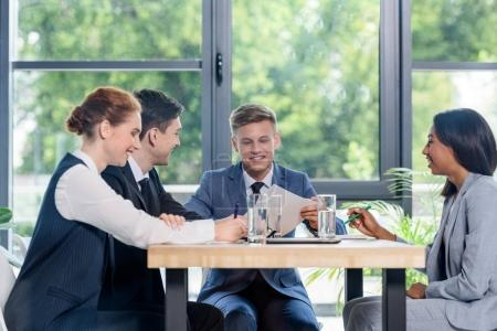 Diverse business team discussing project in modern office