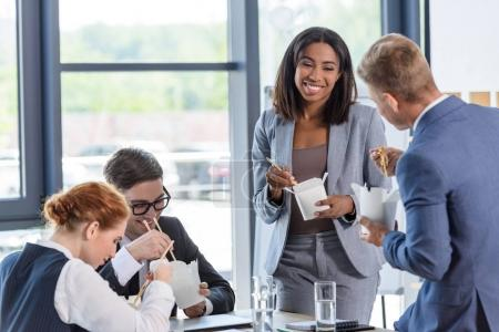 Business team eating chinese food during meeting break in modern office