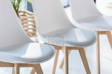 Photo for White chairs in light modern office - Royalty Free Image