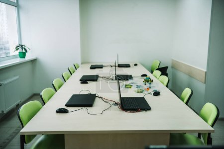Photo for Interior of empty classroom with laptops on desk at stem education courses - Royalty Free Image
