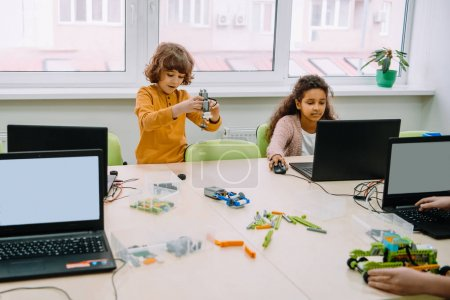 group of kids learning together, stem education concept