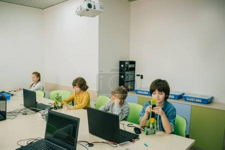 Photo for Group of focused kids working on projects at stem education class - Royalty Free Image