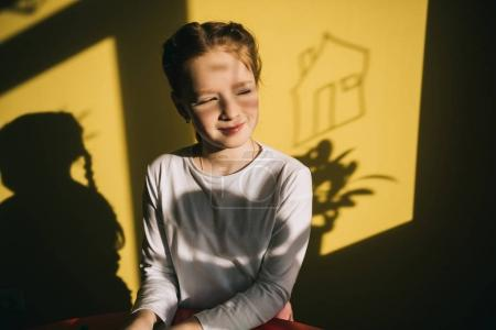 smiling little child indoor under sunset light