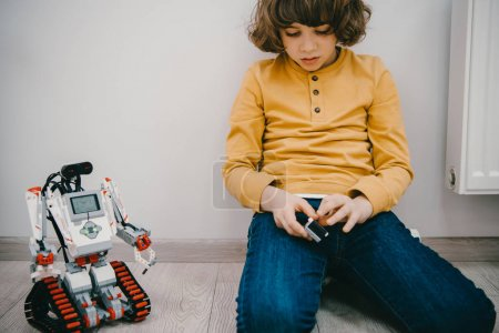 adorable little kid sitting on with diy robot