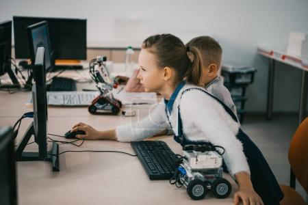 concentrated teen child programming robot at class, stem education concept