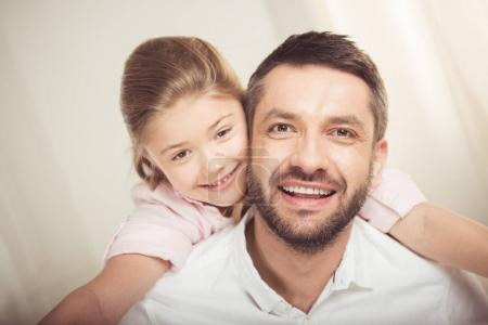 Photo for Close-up portrait of happy father and daughter hugging and smiling at camera - Royalty Free Image