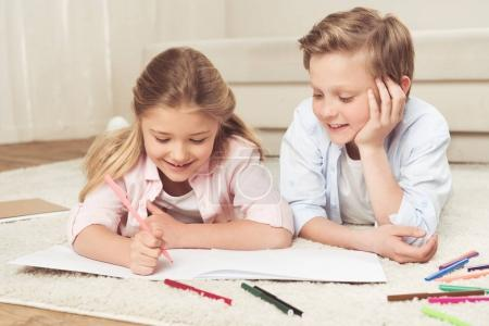 adorable kids drawing pictures at home