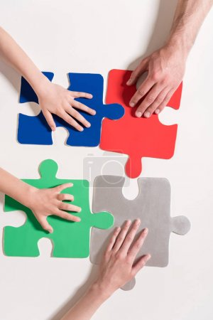 Hands on puzzle pieces