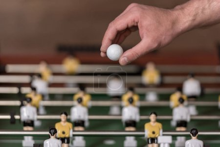 foosball and hand with ball