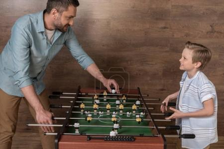 Photo for Happy boy playing foosball together with father - Royalty Free Image