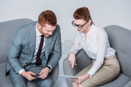 businesspeople using tablet