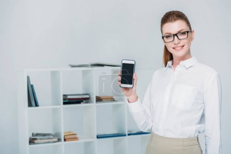 beautiful businesswoman with smartphone
