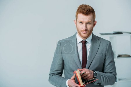 handsome businessman with book