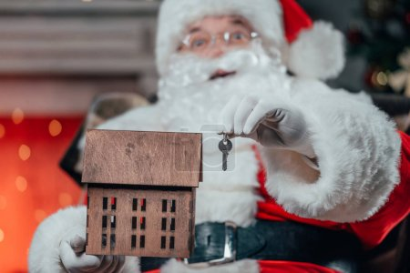 santa with house model and key