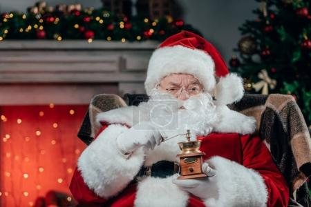santa claus with coffee grinder