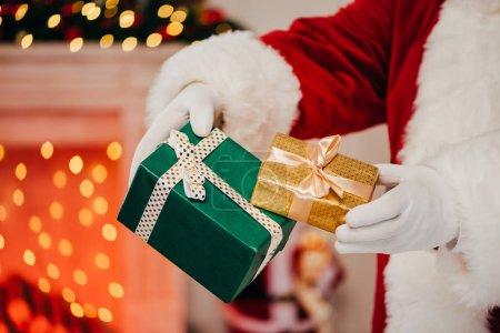 santa holding gift boxes