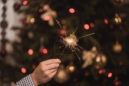 kid holding sparkler