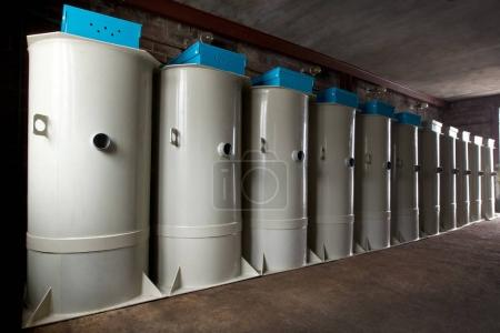 A row of european septic tank stations (autonomous sewage system) at warehouse