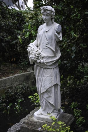 Spring figure statue. Heritage marble statuary at the Royal Botanic Gardens, Sydney.