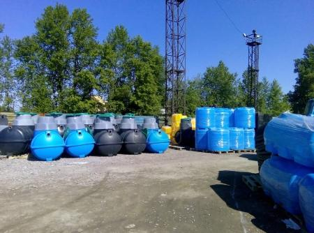 Stacks of septic tanks and other storage tanks at the shipment depot