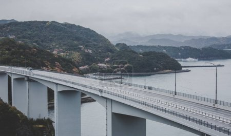 Great Naruto Bridge with gray sky background in cloudy day at Tokushima