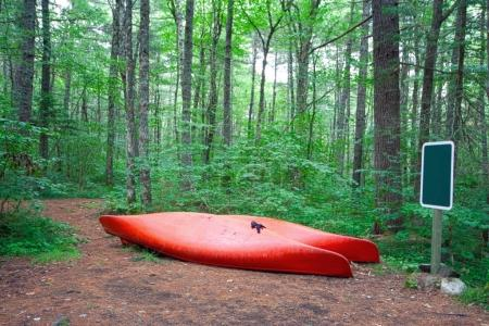 two red canoes or kayaks