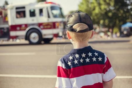 Boy watching an Independence Day Parade