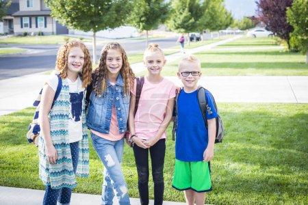 cute school kids with backpacks