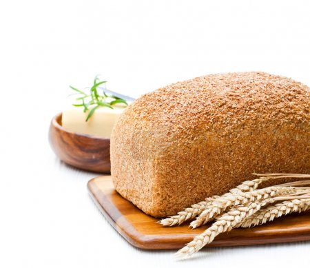Whole  slow-baked organic wholemeal bread with butter and rosema