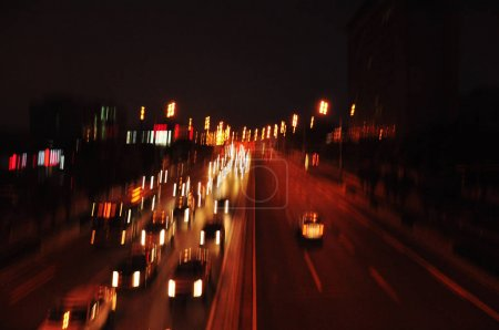 Photo for Blurred view of busy highway with vehicles at night - Royalty Free Image