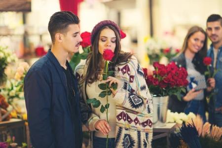 Relations, love, romance concept -  happy young couples with flo
