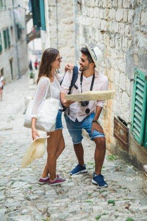 Photo for Tourist couple enjoying sightseeing and exploring city - Royalty Free Image