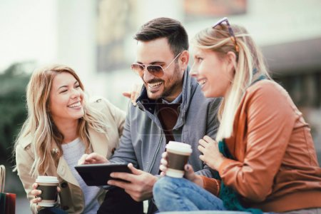 friends with digital tablet