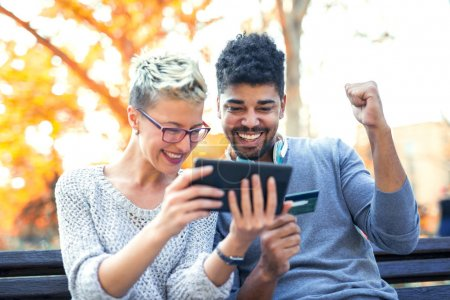 mixed race couple using tablet