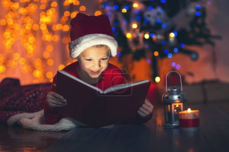 child opening Christmas book