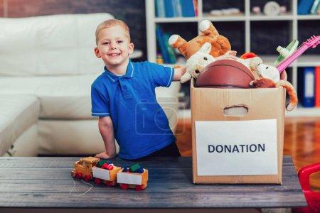 boy taking donation box