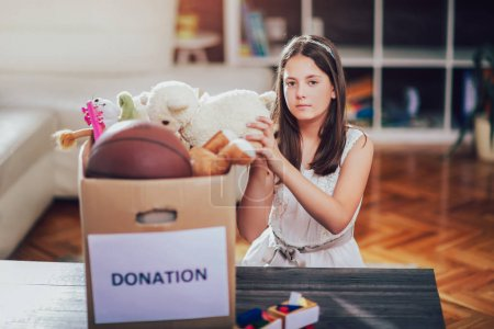 girl taking donation box