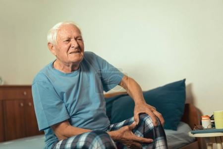 senior man suffering from osteoarthritis pain in knee
