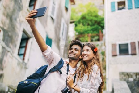 Couple using digital tablet on journey
