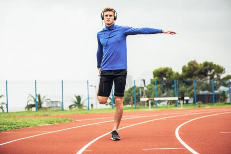 Man running on a running track