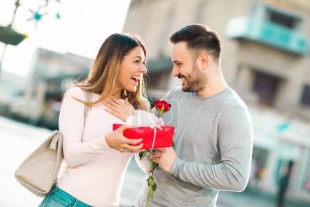 Man surprises woman with a gift in the city