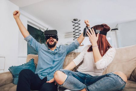 Photo for Young man and woman in casual clothes wear the virtual reality glasses are watching and showing imagine via the VR camera, Technology and innovation concept - Royalty Free Image